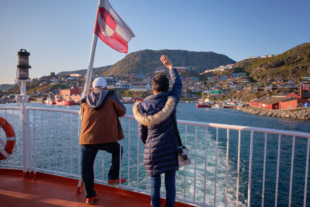 Locals waving goodbye to loved ones from the top deck of Sarfaq Ittuk as we leave Qaqortoq
