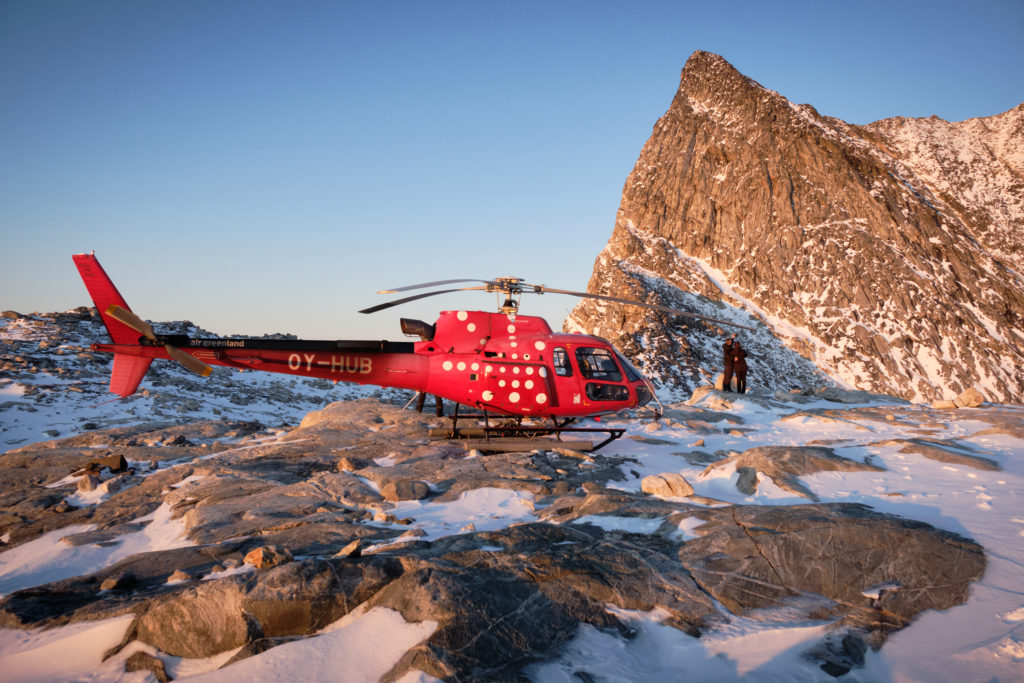 helicopter and people on the ridge in front of the summit of Sermitsiaq - Nuuk - West Greenland