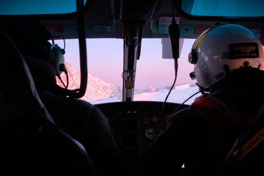 looking out the front window between the pilot and passenger on Nuuk helicopter summit flight - West Greenland