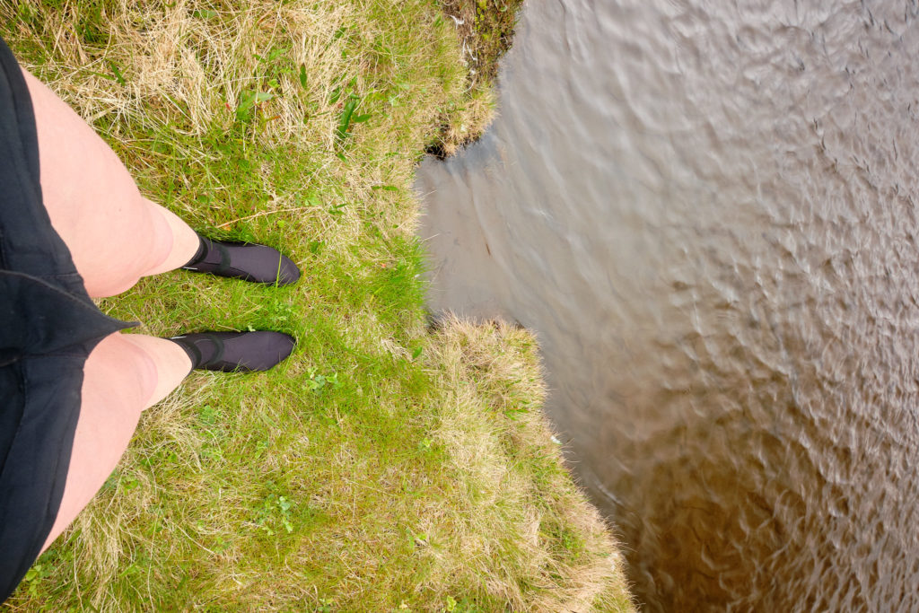 Preparing for river crossing near Horvik  with neoprene socks - Hornstrandir -Iceland