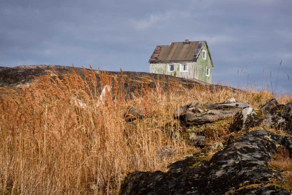 Graveyard and house in the abandoned settlement of Kangeq near Nuuk-Greenland