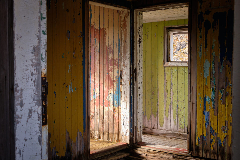 Peeling paint in colourful rooms at the abandoned settlement of Kangeq near Nuuk-Greenland