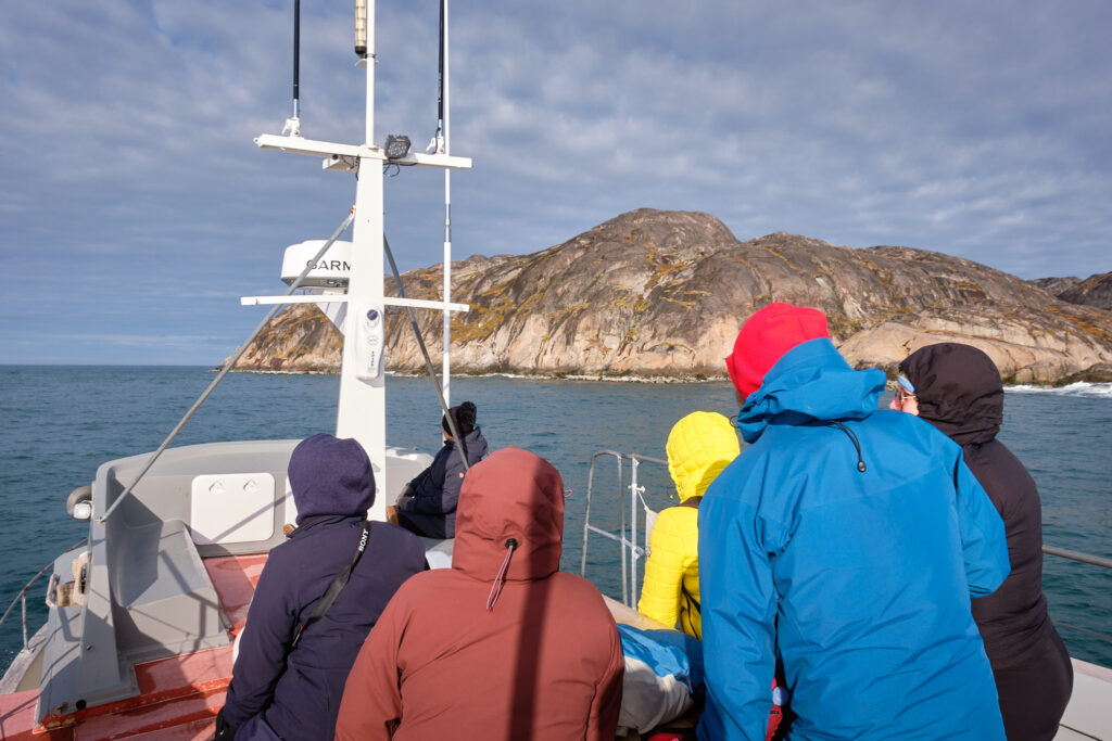 Sitting around picnic table on Kang Tourism closed boat heading to Kangeq-Nuuk-Greenland
