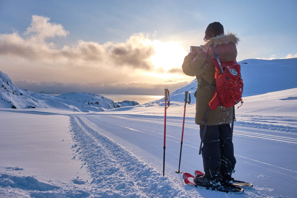 hiker-taking-photograph-of-the-ocean-on-a-snowshoeing-trip-near-sisimiut-1024x683.jpg