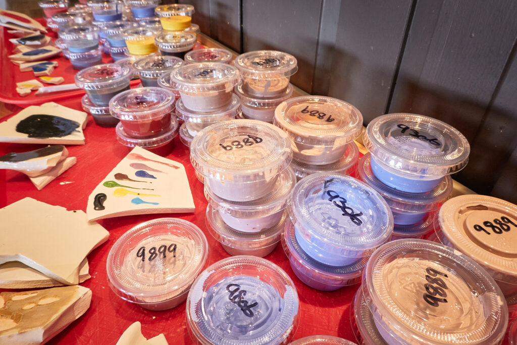 Array of paints to choose from at  Ceramic (KeraMIK) Cafe at the Hotel Sisimiut