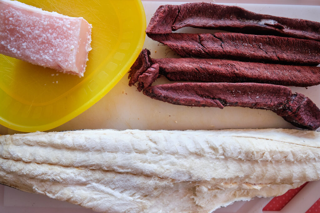 salted whale blubber, dried Minke whale meat and dried cod for lunch at Sassannguit near sisimiut - Greenland