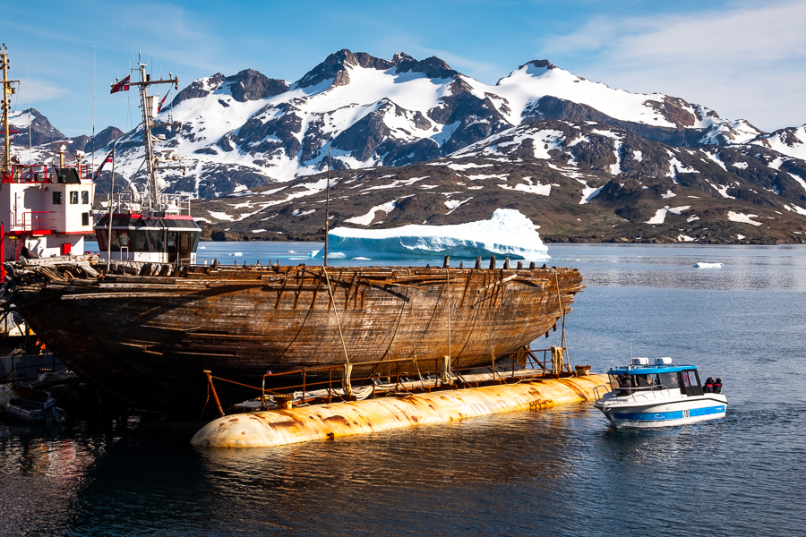 """Locals checking out Roald Amundsen's ship """"Maud"""" at Tasiilaq harbor - East Greenland"""