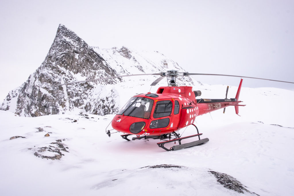 Helicopter landed near the summit of Sermitsiaq mountain near Nuuk, Greenland